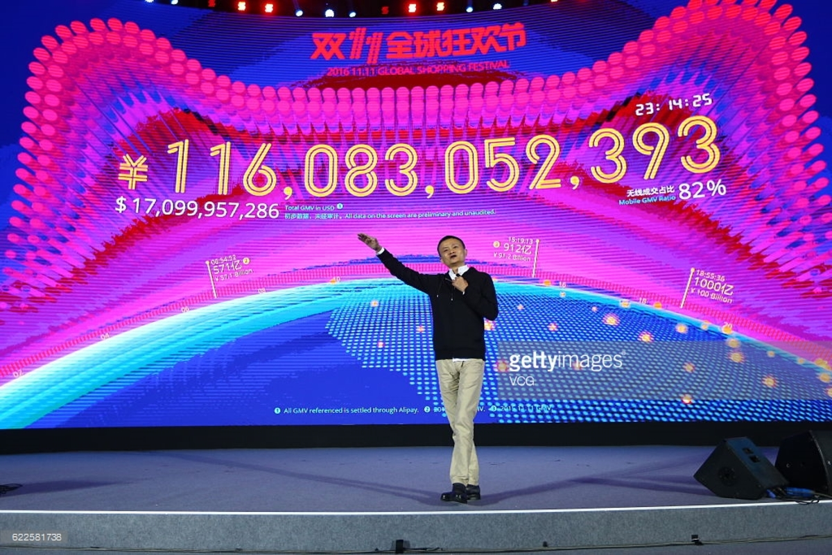 """Jack Ma, Alibaba Founder, stands in front of the Singles' Day Scoreboard, tallying the total Yuan expenditures of the day. """"This is a big event for China, for the Chinese economy,"""" co-founder and Alibaba vice chairman Joseph Tsai said ahead of the sales bonanza. """"On Singles' Day, shopping is a sport, it's entertainment."""""""