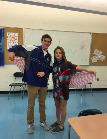 Seniors+Nick+Hoyt+and+Caroline+Cooney+show+off+their+American+flag+capes+in+class.+