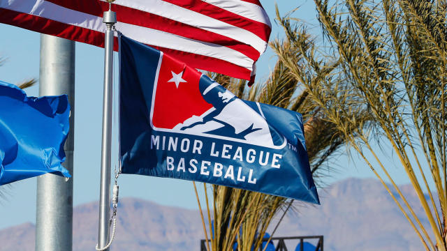 LAS VEGAS, NV - MARCH 08: The American flag waves in the breeze along with the Nevada state flag and a Minor League Baseball flag during Big League Weekend featuring the Chicago Cubs and Cincinnati Reds on March 8, 2020 at Las Vegas Ballpark in Las Vegas, Nevada. (Photo by Jeff Speer/Icon Sportswire via Getty Images)