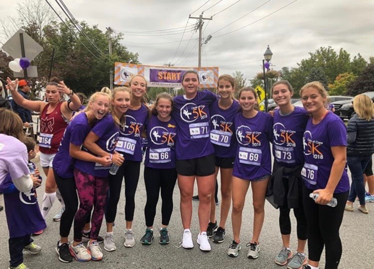 Some of the field hockey players running a 5k for pediatric cancer.