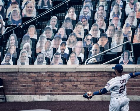 Robinson Canó throws in front of cardboard cutouts